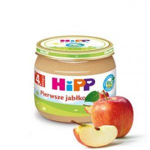 słoiczek dla niemowląt HiPP z musem owocowym pierwsze jabłko, obok słoiczka kawałki jabłek